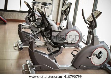diverse equipment and machines at the gym room. - stock photo