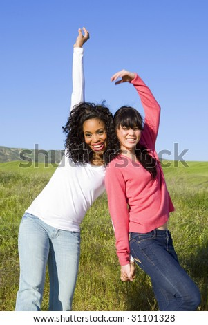 diverse friends enjoying the bright summer day - stock photo