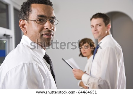 Diverse group of business people, focus on African American businessman in foreground - stock photo