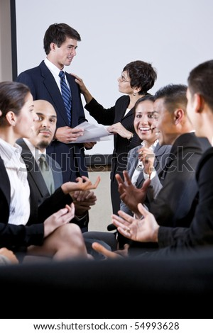 Diverse group of businesspeople conversing, exchanging ideas - stock photo