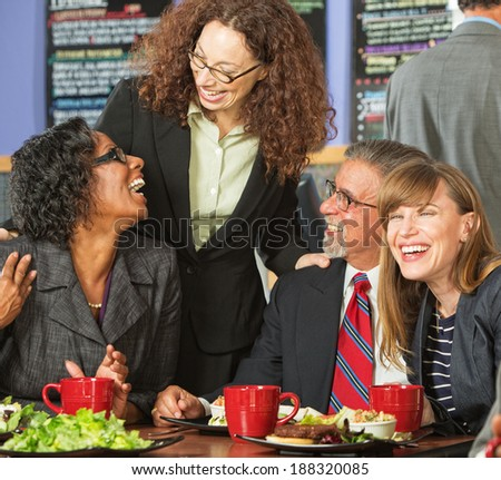 Diverse group of four happy executives having lunch - stock photo