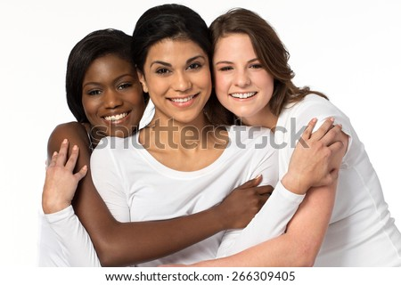 Diverse group of friends hugging - stock photo