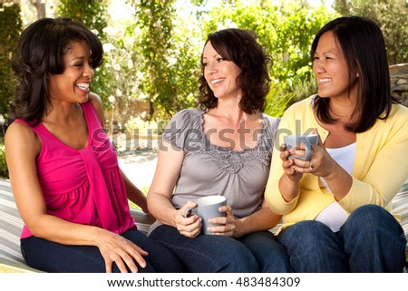 Diverse group of friends laughing and talking.