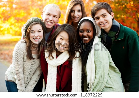 Diverse group of friends smiling together - stock photo