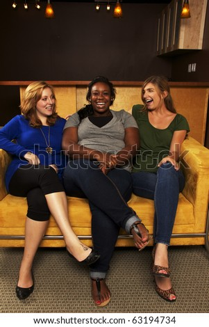 Diverse Group of Girlfriends Laughing - stock photo