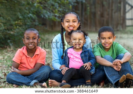 Diverse group of kids smiling - stock photo