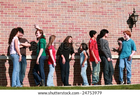 diverse group of multi-ethnic teens talking outside - stock photo