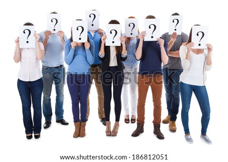 Diverse group of people holding question signs. Isolated on white - stock photo