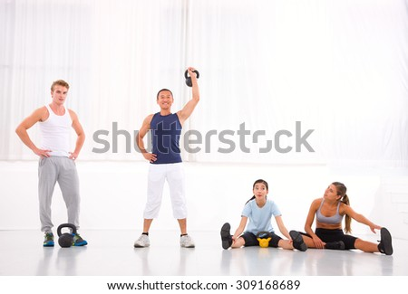 Diverse group of people in gym - stock photo