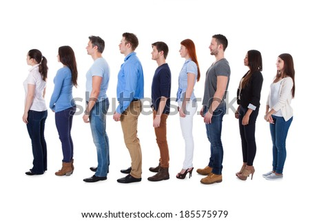 Diverse group of people standing in row. Isolated on white - stock photo