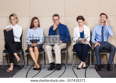 Diverse Group of People Waiting for Interview