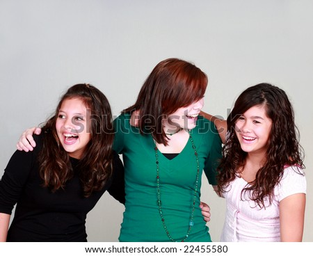 diverse group of three pretty girls laughing - stock photo