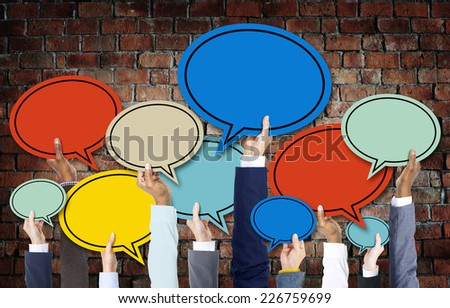 Diverse Hands Holding Colorful Speech Bubbles - stock photo