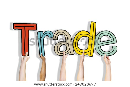 Diverse Hands Holding the Word Trade - stock photo