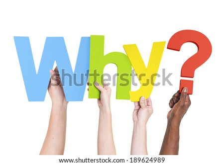 Diverse Hands Holding The Word Why? - stock photo