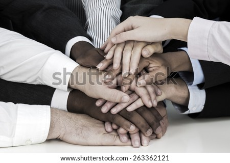 Diverse hands stacked - stock photo