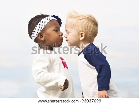 Diverse Little Kids about to Kiss - stock photo