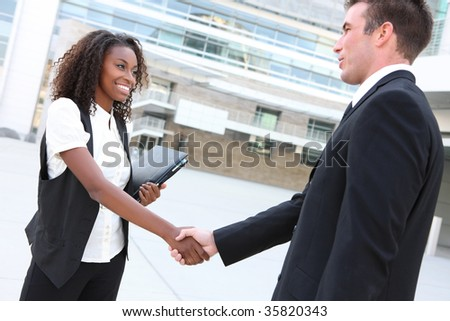 Diverse Man and Woman Business Team shaking hands at office building - stock photo
