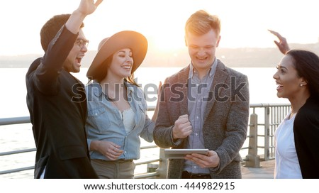diverse multi ethic group of young people enjoying life together outdoors at sunset. happiness lifestyle background. teamwork passion spirit scene - stock photo