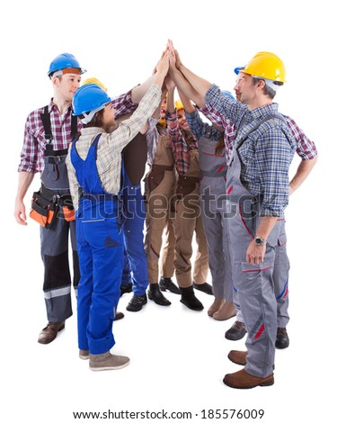Diverse multiethnic group of artisans giving a high five gesture as they stand in a circle showing their commitment and motivation for a team project  isolated on white - stock photo