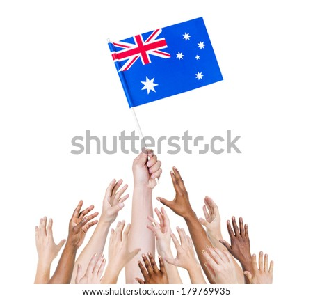 Diverse Multiethnic Hands Holding and Reaching For The Flag of Australia - stock photo