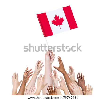 Diverse Multiethnic Hands Holding and Reaching For The Flag of Canada - stock photo
