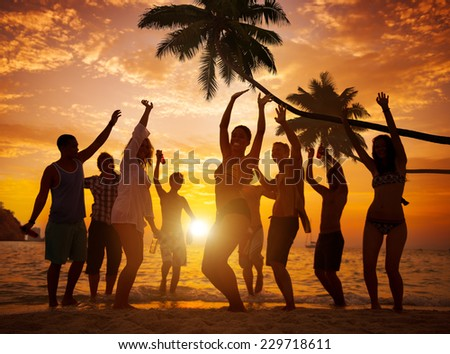 Diverse People Dancing and Partying on a Tropical Beach - stock photo