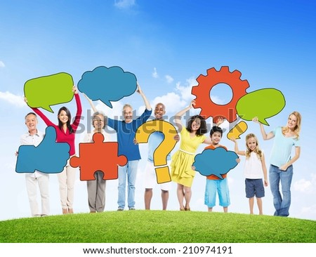 Diverse People Holding Symbols On a Hill - stock photo