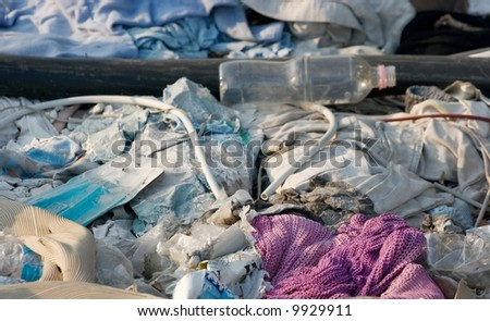 Diverse rubbish on the ground - stock photo