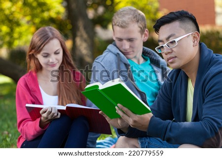 Diverse students learning on a fresh air - stock photo