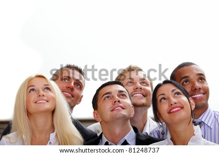 Diverse team of happy business people looking upwards at copyspace