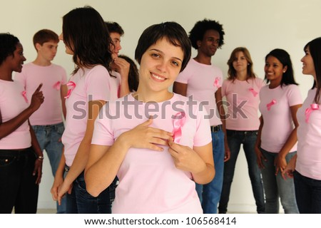 Diverse volunteer group with breast cancer awareness ribbon