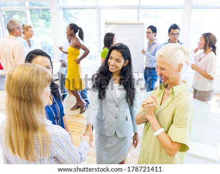 Diverse Women Discussing at Community Center - stock photo