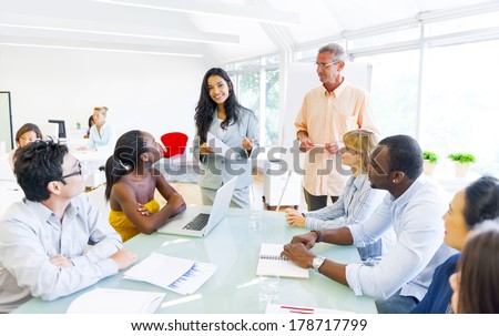 Diverse World Business People at Table in Office - stock photo