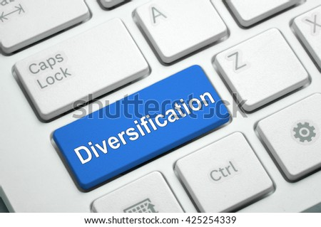 Diversification text written on Blue button White Keyboard