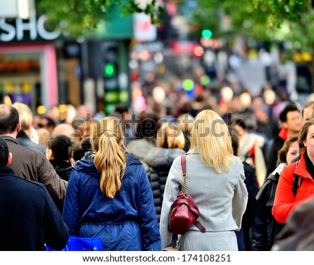 Diversified crowd on shopping street - stock photo
