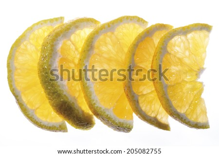 Diversified slices of ugli (citrus fruit), elevated view, close-up - stock photo