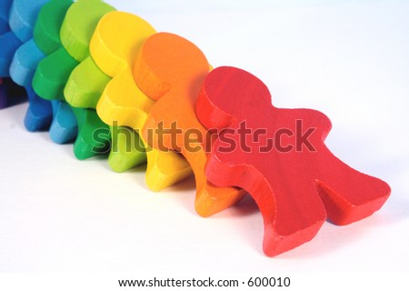 Diversity - colorful, wooden domino people falling down. - stock photo