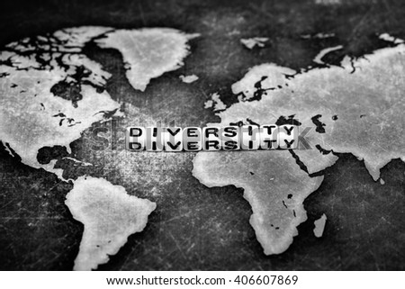 DIVERSITY on grunge world map, black and white