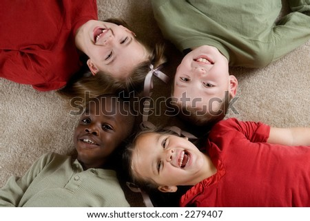 Diversity Series - Four children playing together. - stock photo