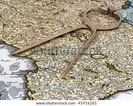 Divider on a map from XVIII century. - stock photo