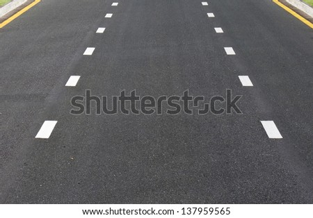Dividing line on surface road - stock photo