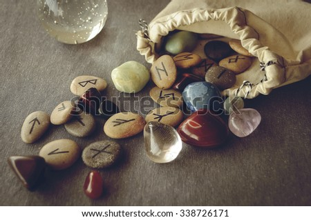 divination and prediction on runes and Tarot, mysticism or esoteric isolated on grey background - stock photo