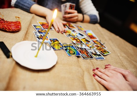 Divination by the Tarot cards. The fortune teller predicts the fate of the cards