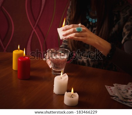 Divination with candle - stock photo
