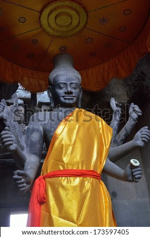 Divine statue inside the Angkor Wat temple, Cambodia. Angkor is largest religious monument in the world.  - stock photo