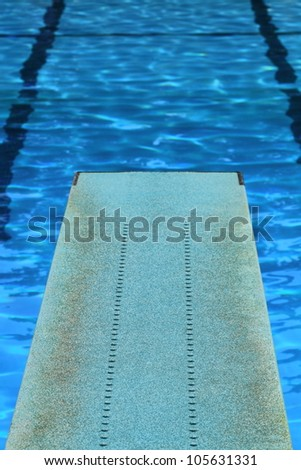 Diving board and pool - stock photo
