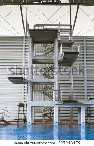 Diving tower in swimming pool for competition - stock photo
