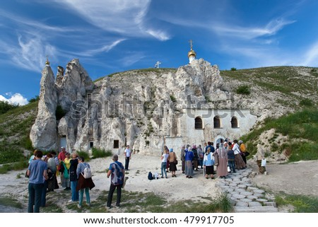 DIVNOGORIE, VORONEZH REGION, RUSSIA - JUNE 12, 2016: People near the Orthodox cathedral carved out of natural rock, Russia, Voronezh region, museum Divnogorie, June 12, 2016