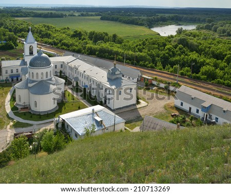 DIVNOGORIE, VORONEZH REGION, RUSSIA - JUNE 8, 2014: View to the Divnogorsky male monastery with the Church of the Assumption. The church was found in XVII century, and last time restored in 2003